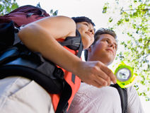 Couple with backpacks and compass Royalty Free Stock Image