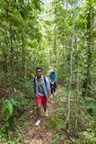 Couple With Backpacks Trekking On Forest Path, Young Man And Woman Holding Hands Walk On Hike Tourists stock images