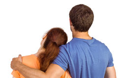 Couple with backs to camera. On white background royalty free stock photo