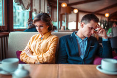 Couple in a bad mood sitting in restaurant Royalty Free Stock Photos