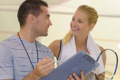 Couple at badminton training Stock Images
