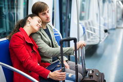 Couple with baggage in car Stock Photography