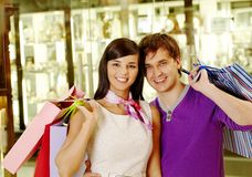 Couple with bags Stock Images