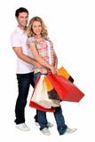 Couple with bags. Young couple with several  bags Royalty Free Stock Photography