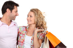 Couple with bags Stock Photos