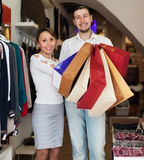 Couple with bags at clothing store Royalty Free Stock Photos