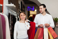 Couple with bags at fasion store Stock Image