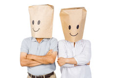 Couple with bags on head Stock Image