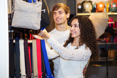 Couple with the bags. In their hands royalty free stock image