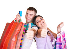 Couple with bags and with thumbs up Stock Photo