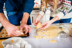 Couple baking Christmas cookies in kitchen Stock Photos