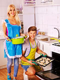 Couple baking cookies in the oven Stock Photo