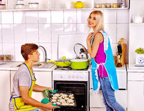 Couple baking cookies in the oven Royalty Free Stock Images