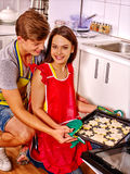 Couple baking cookies in the oven Royalty Free Stock Photos