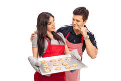 Couple baking and eating cookies together Royalty Free Stock Photo