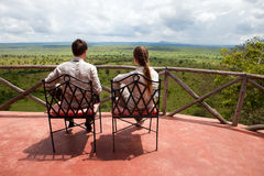 Couple on balcony of safari lodge Stock Photos