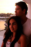 Couple on balcony at sunset Royalty Free Stock Images