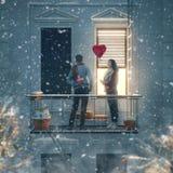 Couple on balcony on Valentine`s day stock image