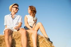 Couple on a bale of hay Stock Photography