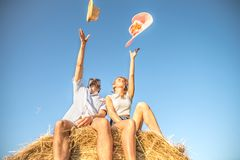 Couple on a bale of hay Stock Photos