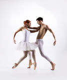 Couple of ballet dancers on a light background Royalty Free Stock Photography