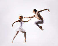 Couple of ballet dancers on a light background. Couple of young and attractive ballet dancers. Image is taken on a light background Royalty Free Stock Images