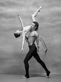 Couple of ballet dancers posing over gray background Stock Photography