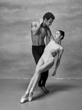 Couple of ballet dancers posing over gray background Royalty Free Stock Photos