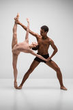 Couple of ballet dancers posing over gray background Royalty Free Stock Photography