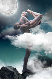 Couple of ballet dancers posing over gray fantasy background. Couple of ballet dancers dancing over gray fantasy background Royalty Free Stock Photo