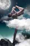 Couple of ballet dancers posing over gray fantasy background Stock Photos