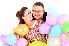 Couple and ballons Stock Photos
