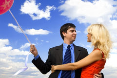 Couple with balloons. Over sky Stock Photography