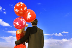 Couple with balloons. Over sky Royalty Free Stock Photos