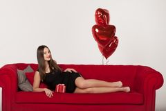 Couple with balloons in Valentine Day stock photography