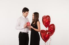 Couple with balloons in Valentine Day royalty free stock photography