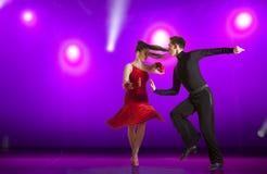 Couple ballroom dancing on illumination. Beautiful couple ballroom dancing on illumination background royalty free stock photo