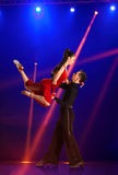 Couple ballroom dancing on illumination. Beautiful couple ballroom dancing on illumination background Stock Photo