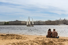 A couple on the bank of the Hare Island. stock photos
