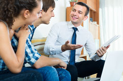 Couple and banking agent discussing Royalty Free Stock Image