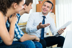 Couple and banking agent discussing Stock Images