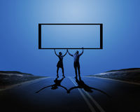 Couple with banner Royalty Free Stock Photos