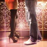 Couple at the bar. Pair at the bar in sexy boots Stock Photos