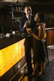 Couple at bar. African-American couple having drinks at the bar Stock Images