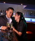 Couple at bar with champagne Royalty Free Stock Photo
