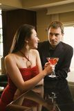 Couple at bar with drinks. Royalty Free Stock Photography