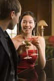 Couple at bar with drinks. stock photo