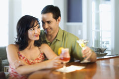Couple at Bar Smiling and Drinking Royalty Free Stock Photos