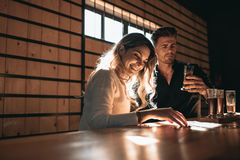 Couple at the bar tasting different varieties of craft beers Stock Image
