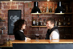Couple at the bar. With two glasses of wine Stock Image